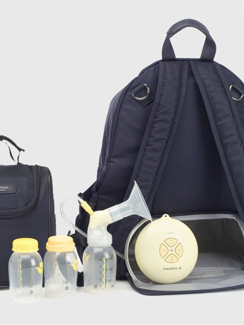 Storksak Hero Navy backpack changing bag, back view showing how to use as a breast pump bag