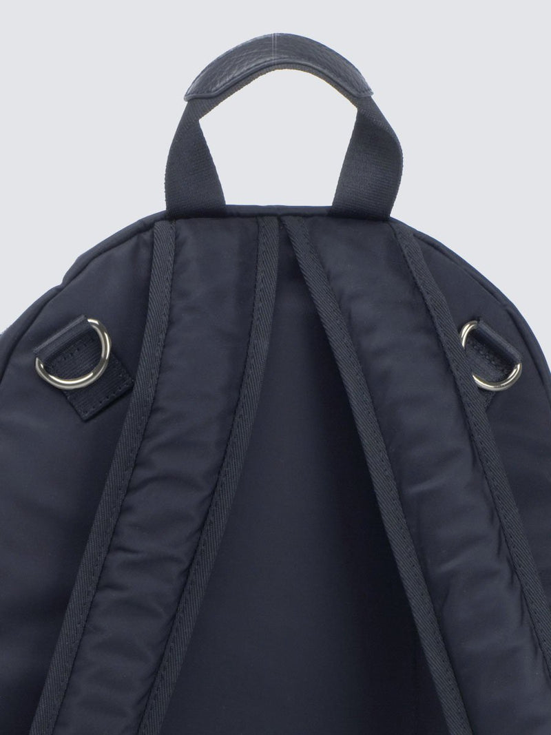 Storksak Hero Navy backpack changing bag, with leather details, back view showing D rings for stroller clips