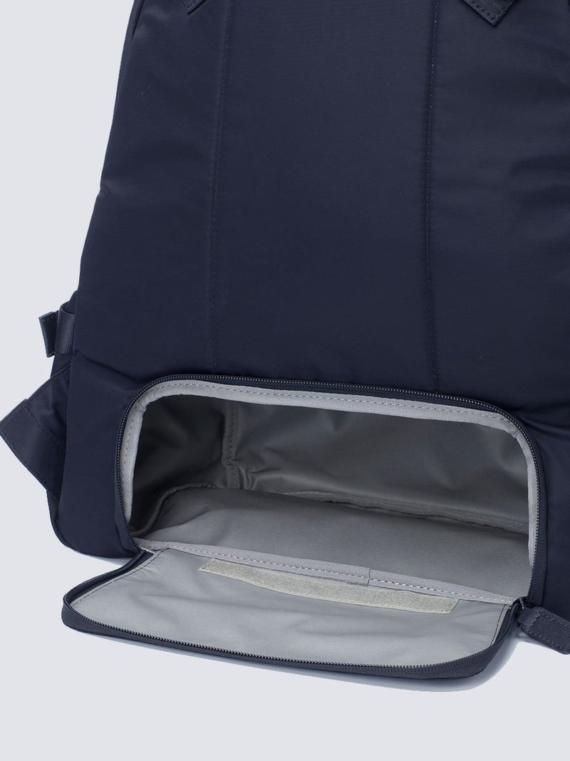 Storksak Hero Navy backpack changing bag, with leather details, back view showing zipped opening to lower compartment and padded back panel