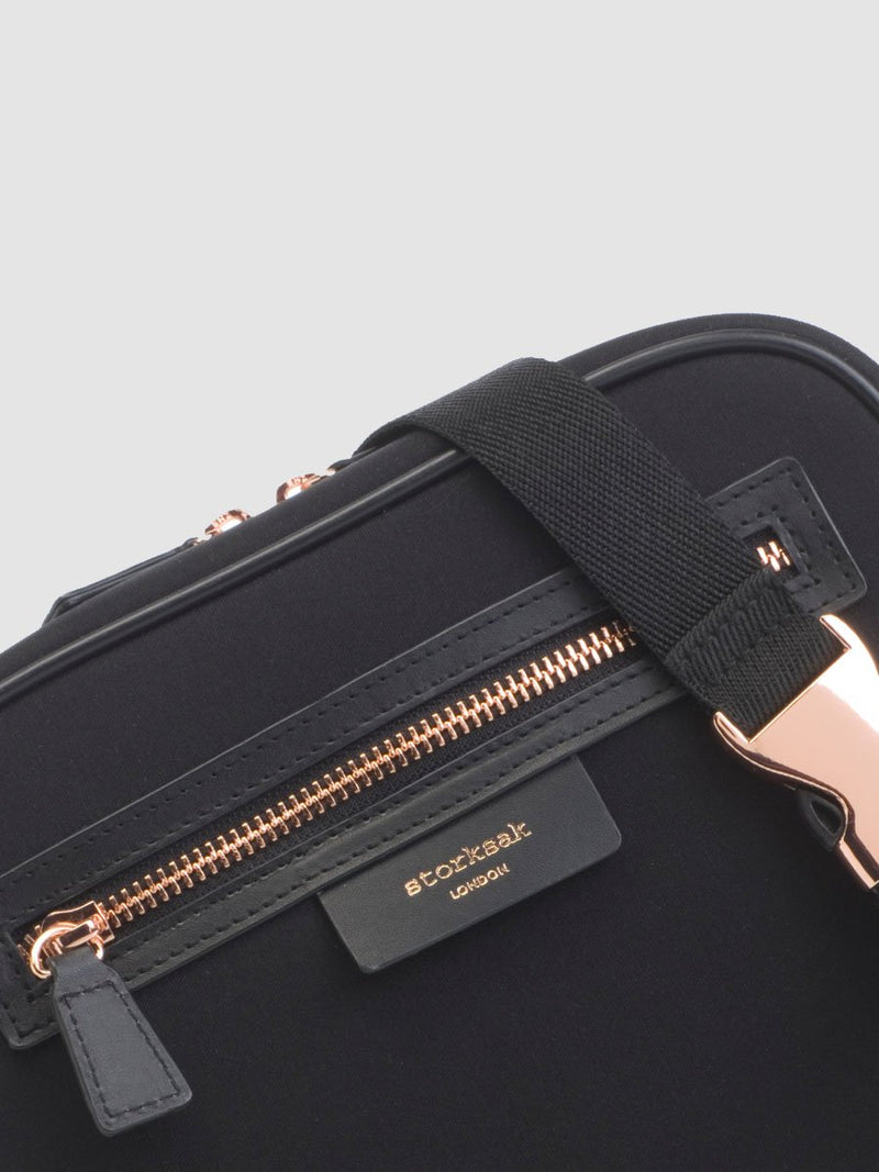 Storksak Belt Bag, small changing bag with convertible strap, close up of scuba material and rose gold hardware