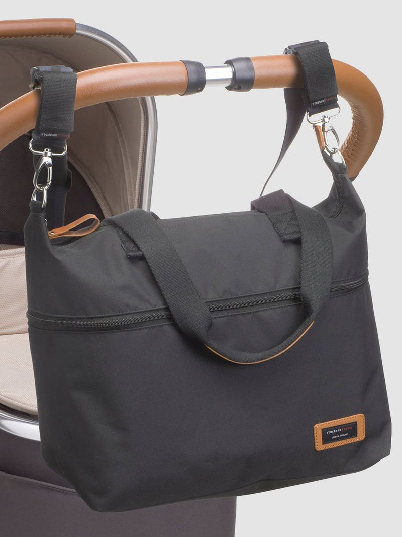 storksak travel expandable tote black, changing bag, attached to pram with stroller straps