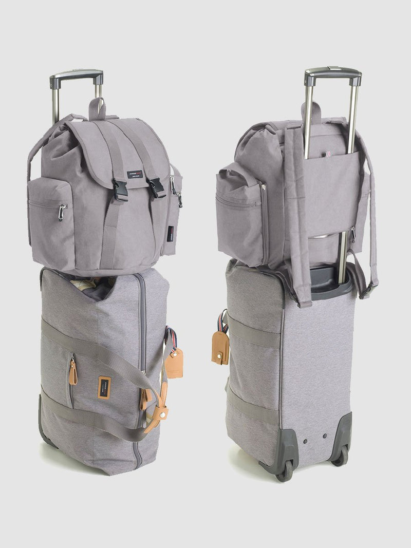 storksak travel backpack grey, rucksack changing bag, bag attached to cabin bag handle