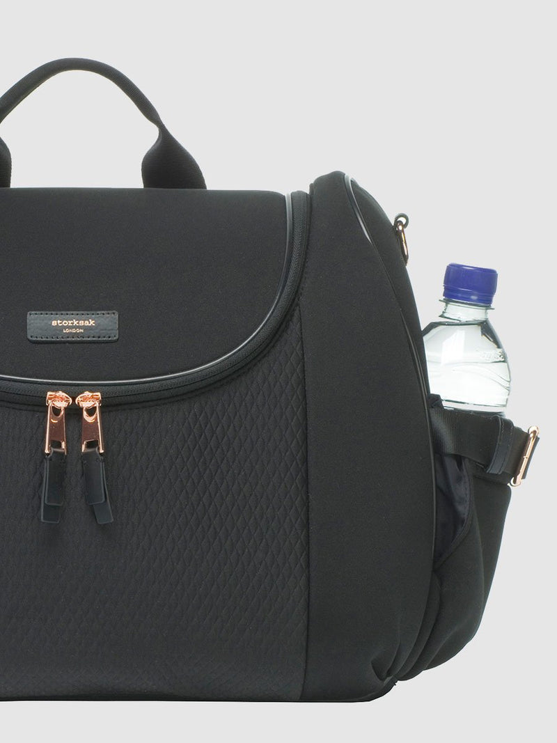 storksak poppy luxe scuba black, convertible changing bag, side view with water bottle in pocket
