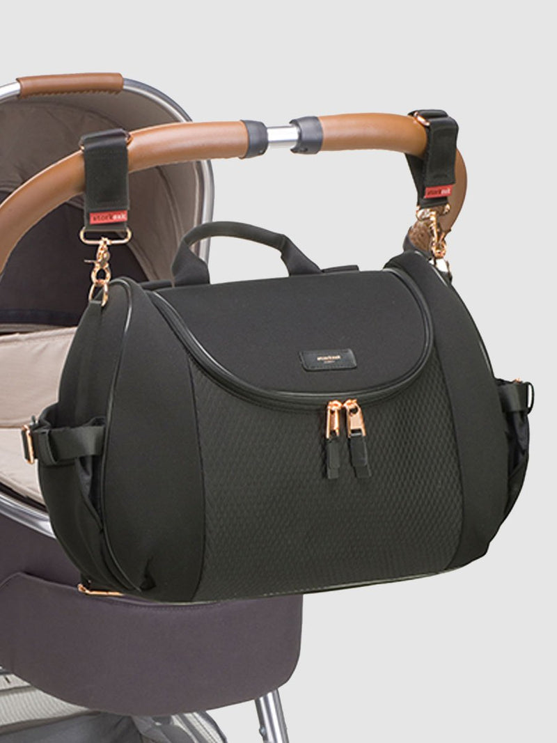 storksak poppy luxe scuba black, convertible changing bag, attached to pram with stroller clips