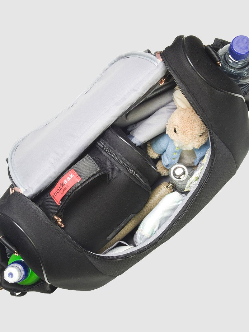 storksak poppy luxe scuba black, convertible changing bag, inside view with baby items inside