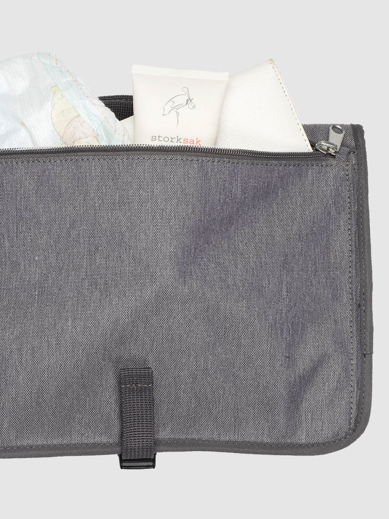 storksak travel change station grey, back pocket for nappies