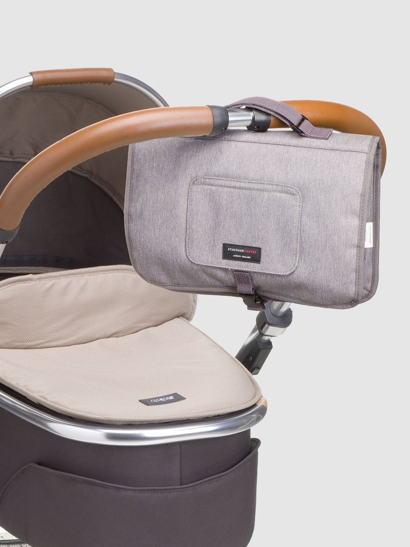 storksak travel change station grey, attached to pram handle