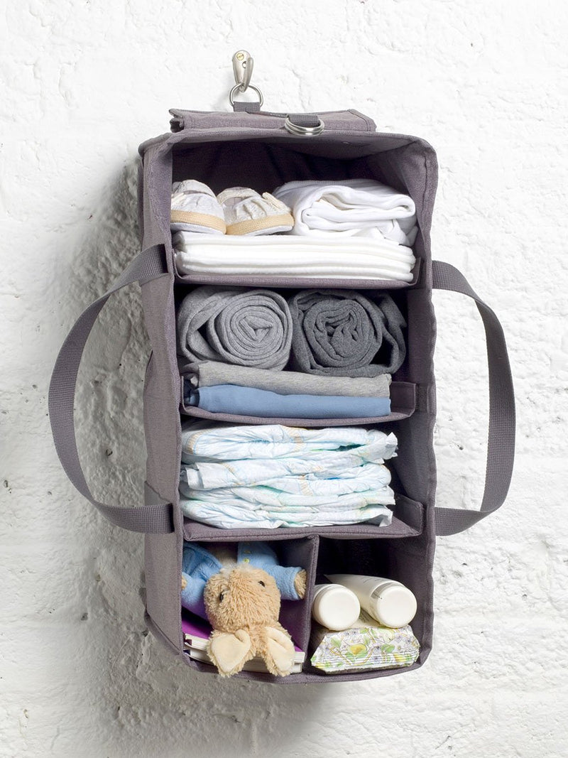 storksak travel cabin carry-on grey, hospital bag, hanging organiser packed with baby items and hung on a hook