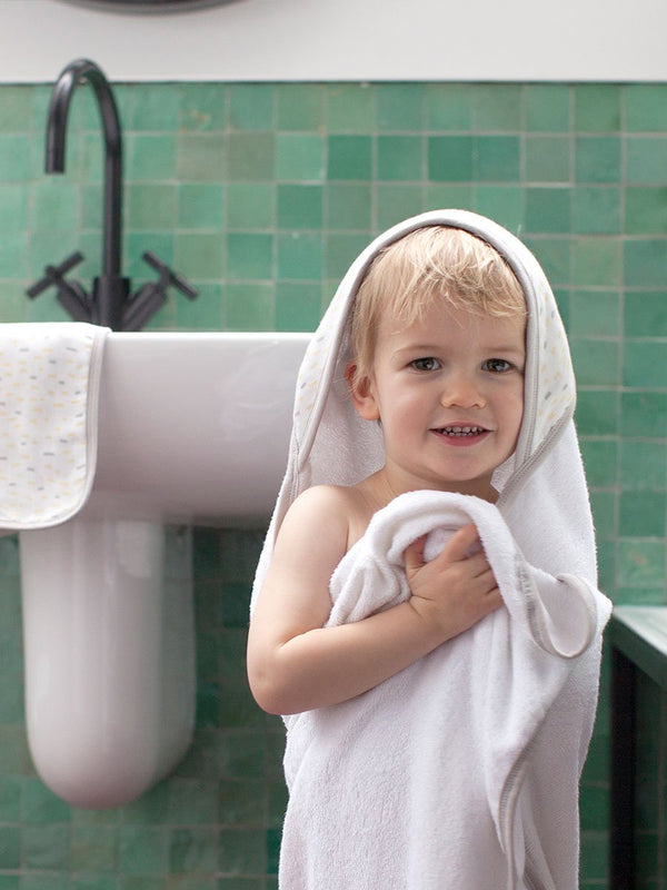 storksak hooded towel a dn washcloth set, silky soft bamboo towelling, raindot print, child wearing towel
