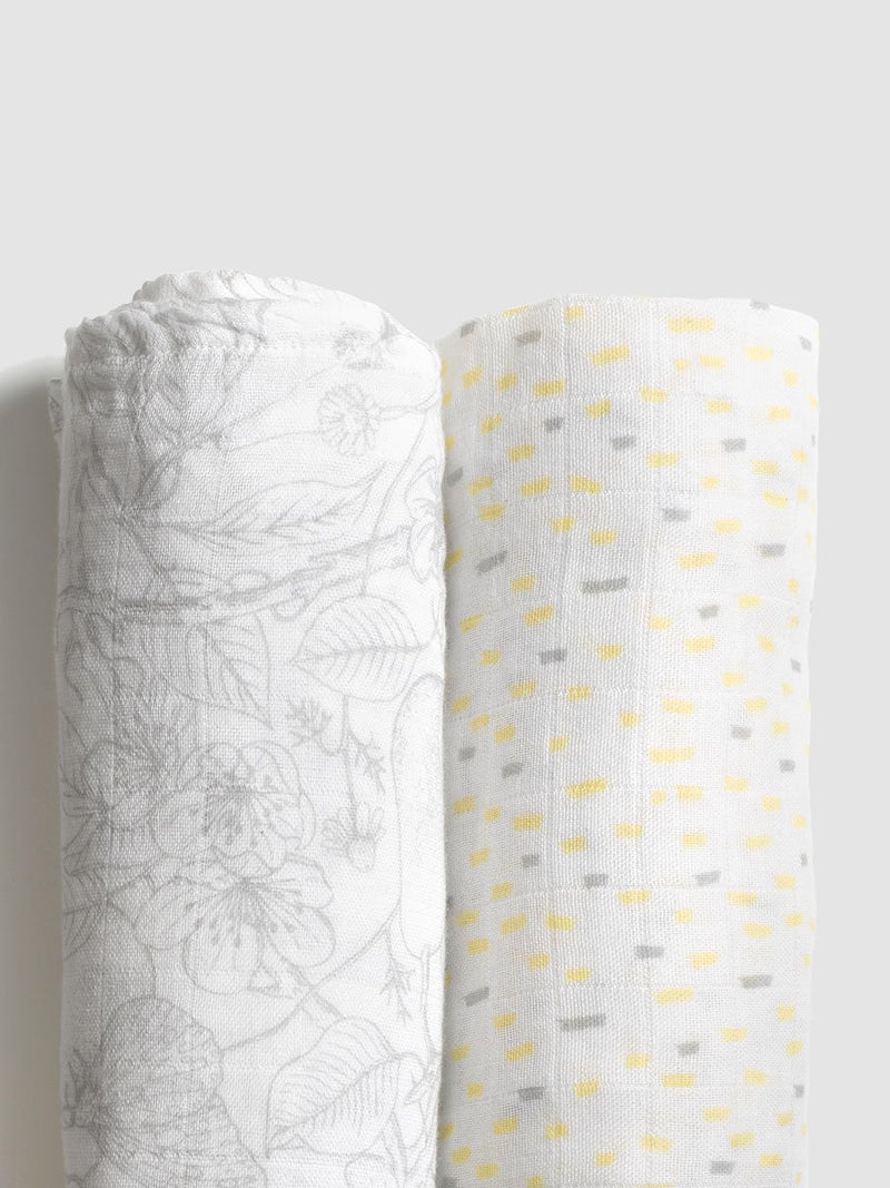 storksak muslin swaddle 2 pack, 120cm x 120cm, rolled up to show 2 print designs