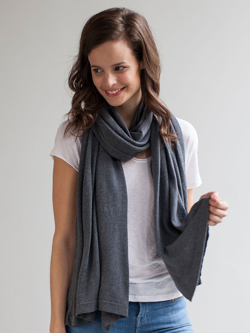 storksak breastfeeding shawl, mother's cocoon nursing cover, charcoal organic cotton, model wearing as scarf