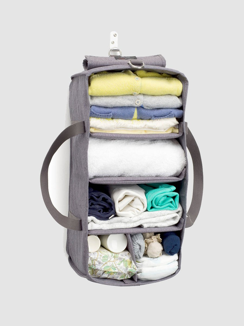 storksak travel hanging organiser grey, hung and hook and packed with baby items