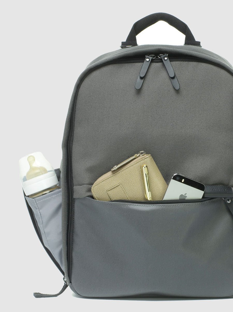 storksak taylor charcoal backpack changing bag, external pockets packed with baby items