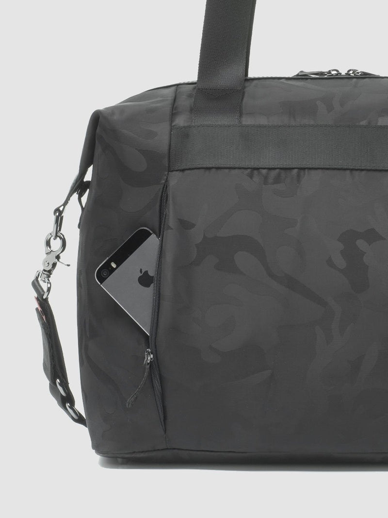 storksak stevie luxe camo black, changing bag, back view showing zipped phone pocket
