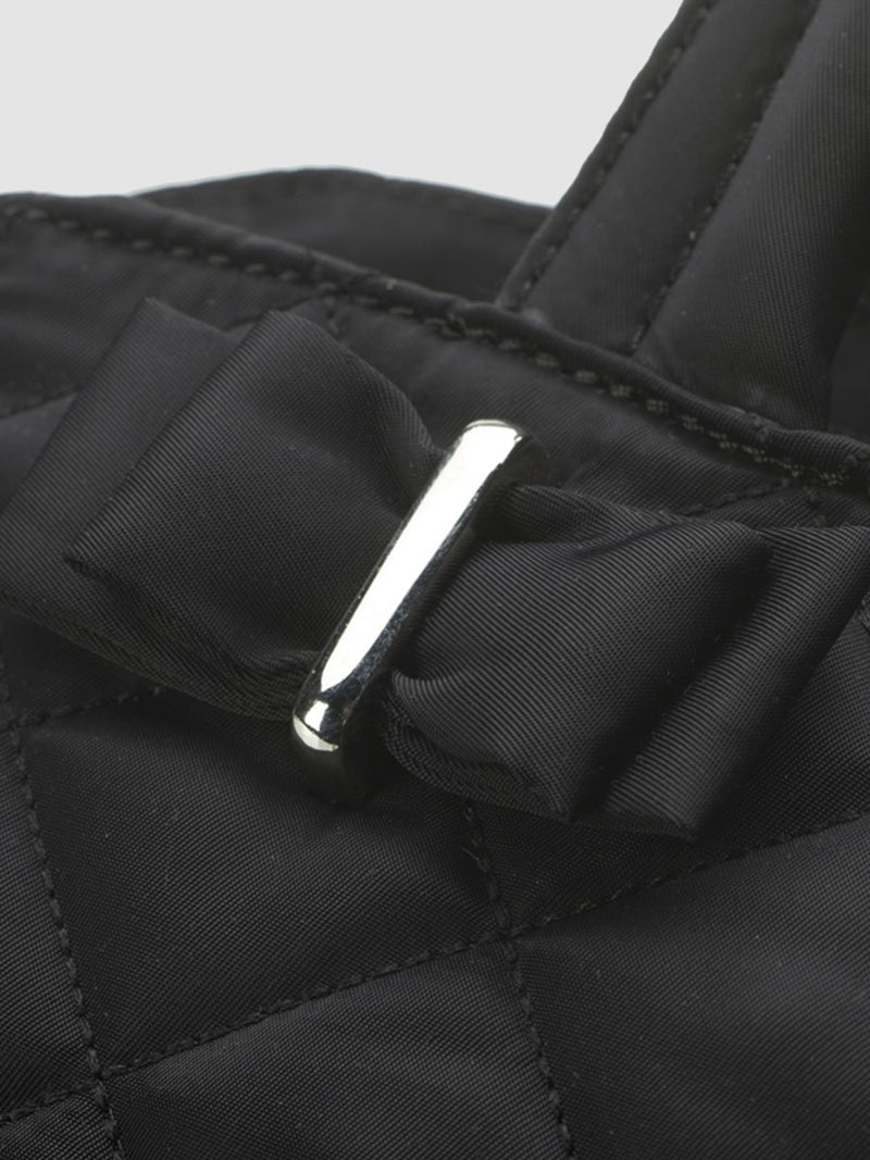 storksak bobby black changing bag, close up of bow detail