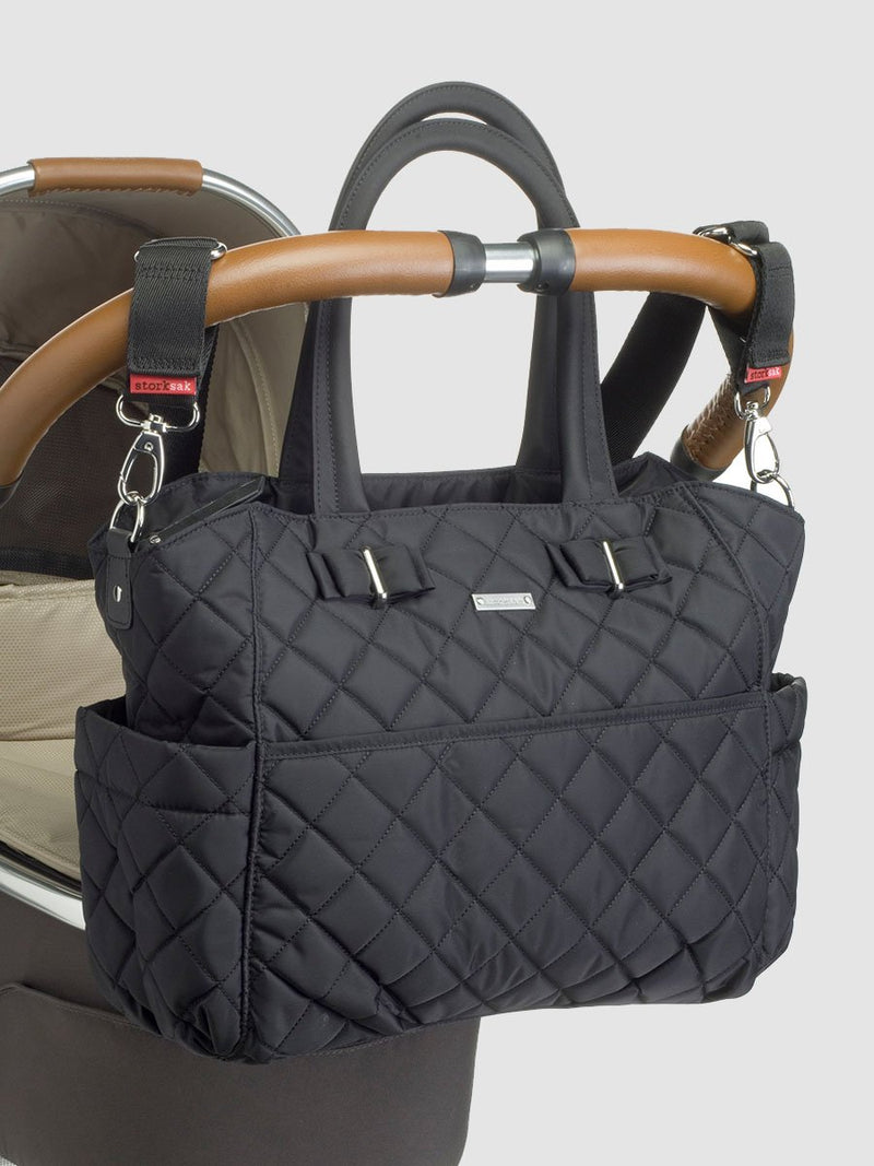 storksak bobby black changing bag, attached to pram with stroller strap