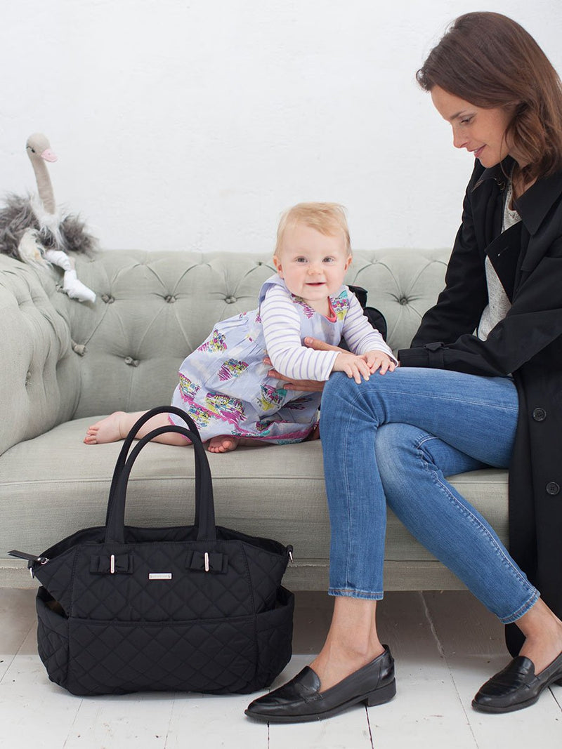 storksak bobby black changing bag, mum and baby with bag