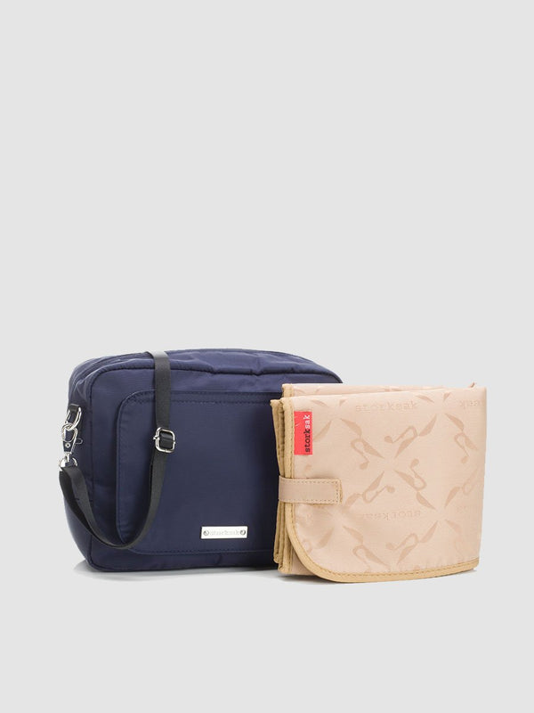 storksak mini-fix navy, small blue changing bag with cross body strap, comes with changing mat