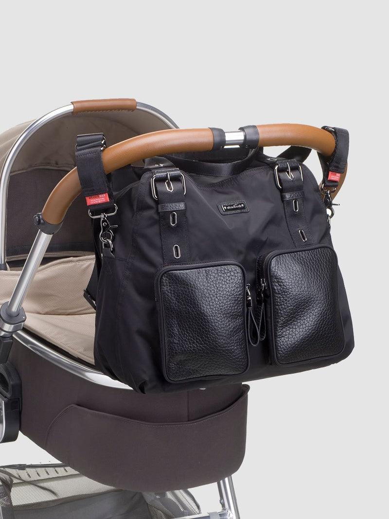storksak alexa luxe  black changing bag, attached to pram with stroller straps