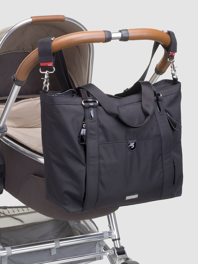 storksak cleo black changing bag, attached to pram with stroller strap