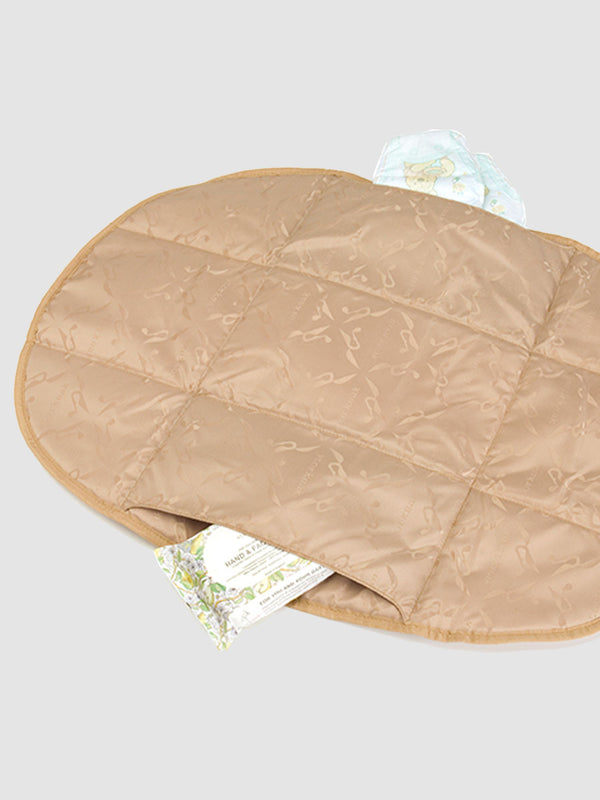 storksak jacquard change station beige, open with wipes and nappies in pockets
