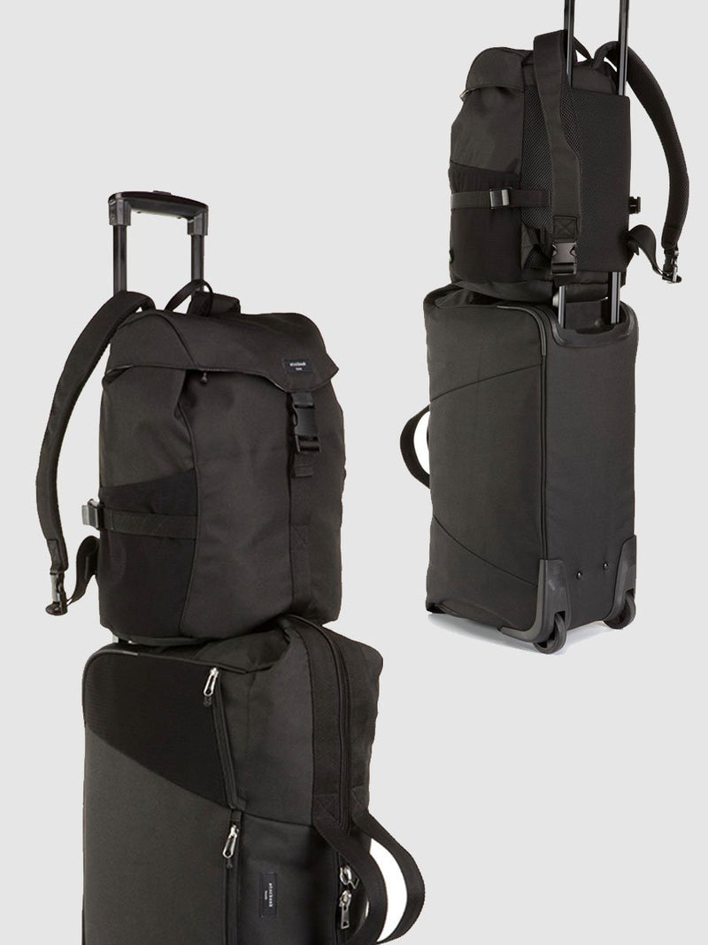 storksak travel eco backpack black, changing bag rucksack, recycled material, shown attached to eco cabin carry-on