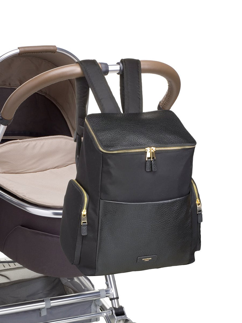 Storksak Alyssa |  Black convertible diaper changing Bag with Gold Zips | attaches to pram with clips on backpack straps