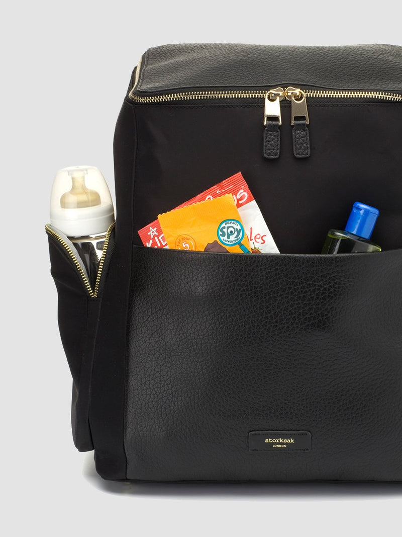 Storksak Alyssa |  Black convertible diaper changing Bag with Gold Zips | side zipped pockets for bottles and easy access front pocket