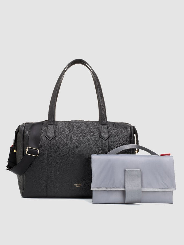 storksak lyra leather black | luxury changing bag | designer leather bag with changing mat