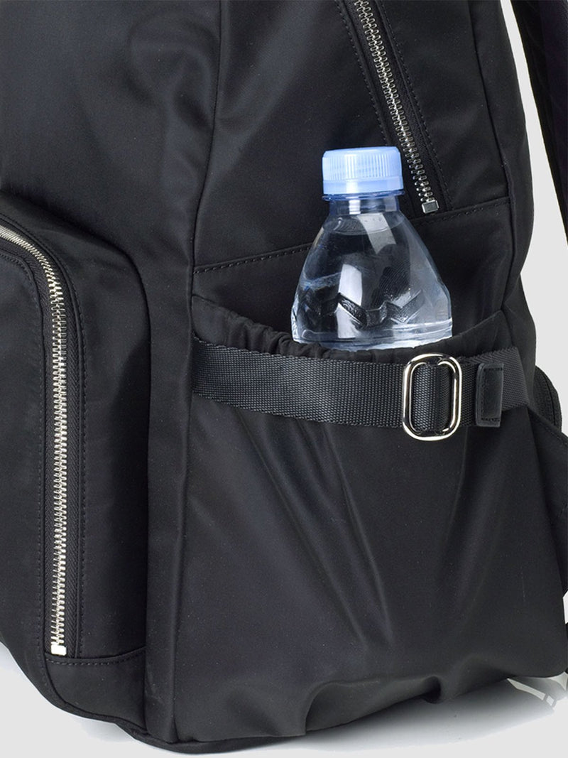 Storksak Hero Black backpack changing bag, side view showing water bottle in pocket