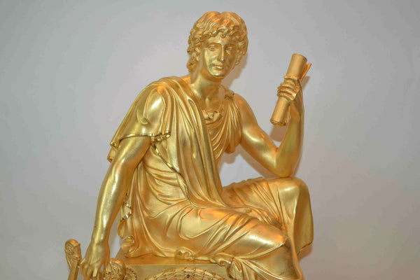 Empire Clock of a Seated Youth Holding a Scroll and Lyre