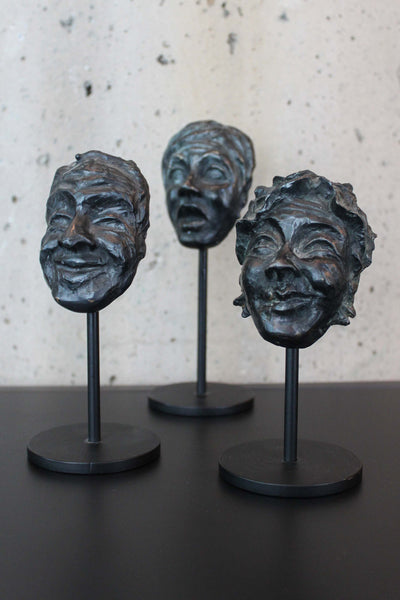 Bronze Masks by Lynn Falconer