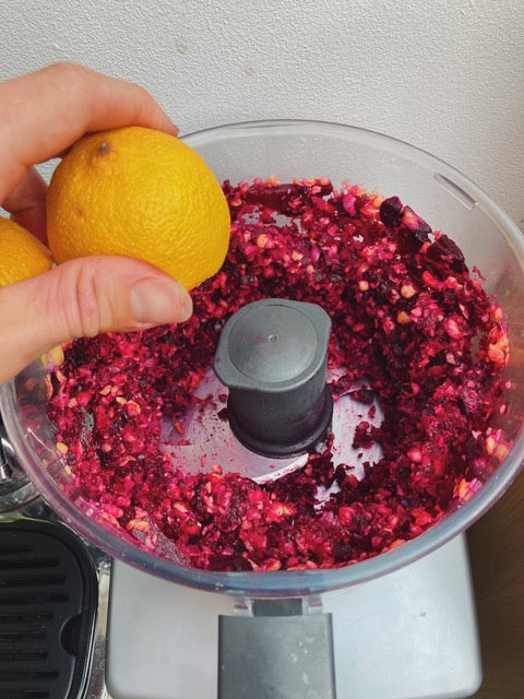 Fresh organic beetroot being blended with freshly squeezed lemon juice