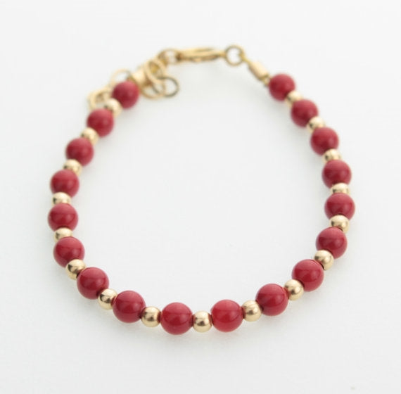 Red Bracelet with Gold Beads