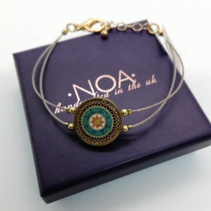 Open image in slideshow, NOA Handmade Brass Framed Ceramic Bracelet