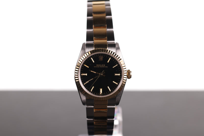 Rolex Oyster Perpetual Black Dial With Gold Fluted Bezel