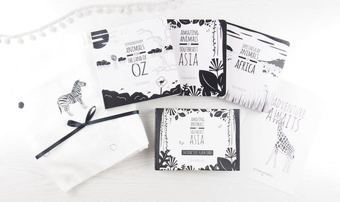 a set of books by the little black and white book project
