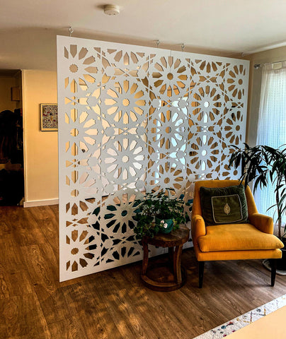 hanging panel room divider screen in cozy apartment with hardwood floors