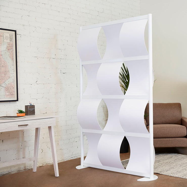modern room divider in home office against white brick and couch chair and plant in home or office