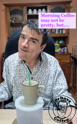 Dr Dazz sitting at table with mug of coffee and plastic straw with caption saying Morning coffee may not be pretty but ...