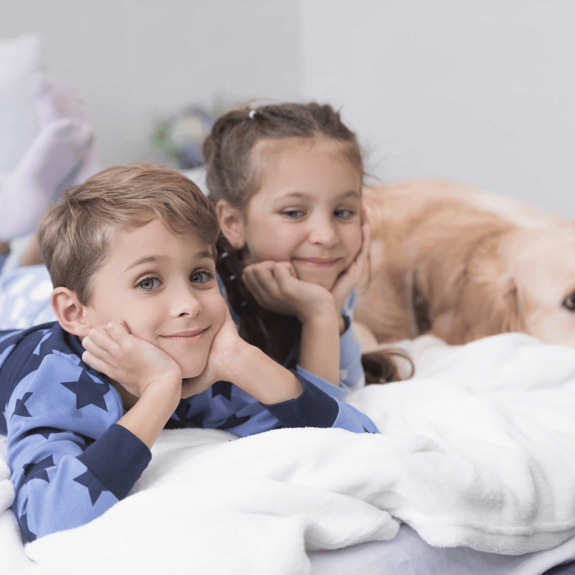 kids and a dog sitting on bed
