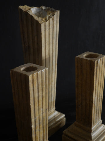Broken marble column candlesticks