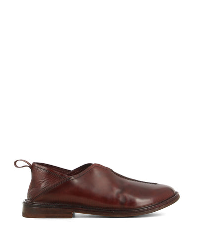 A burgundy Italian leather slip-on loafer that features a pull-on tab at the back for an easy fit, a low 2cm block heel, and a round toe by Moma.