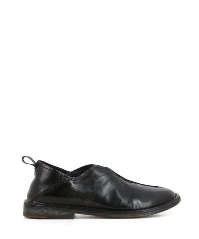 A black Italian leather slip-on loafer that features a pull-on tab at the back for an easy fit, a low 2cm block heel, and a round toe by Moma.