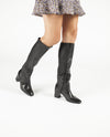 A hand crafted black Italian knee high boot that has zipper fastening, a 6.5cm block heel and an almond toe by Lorenzo Masiero. This style is true to size.