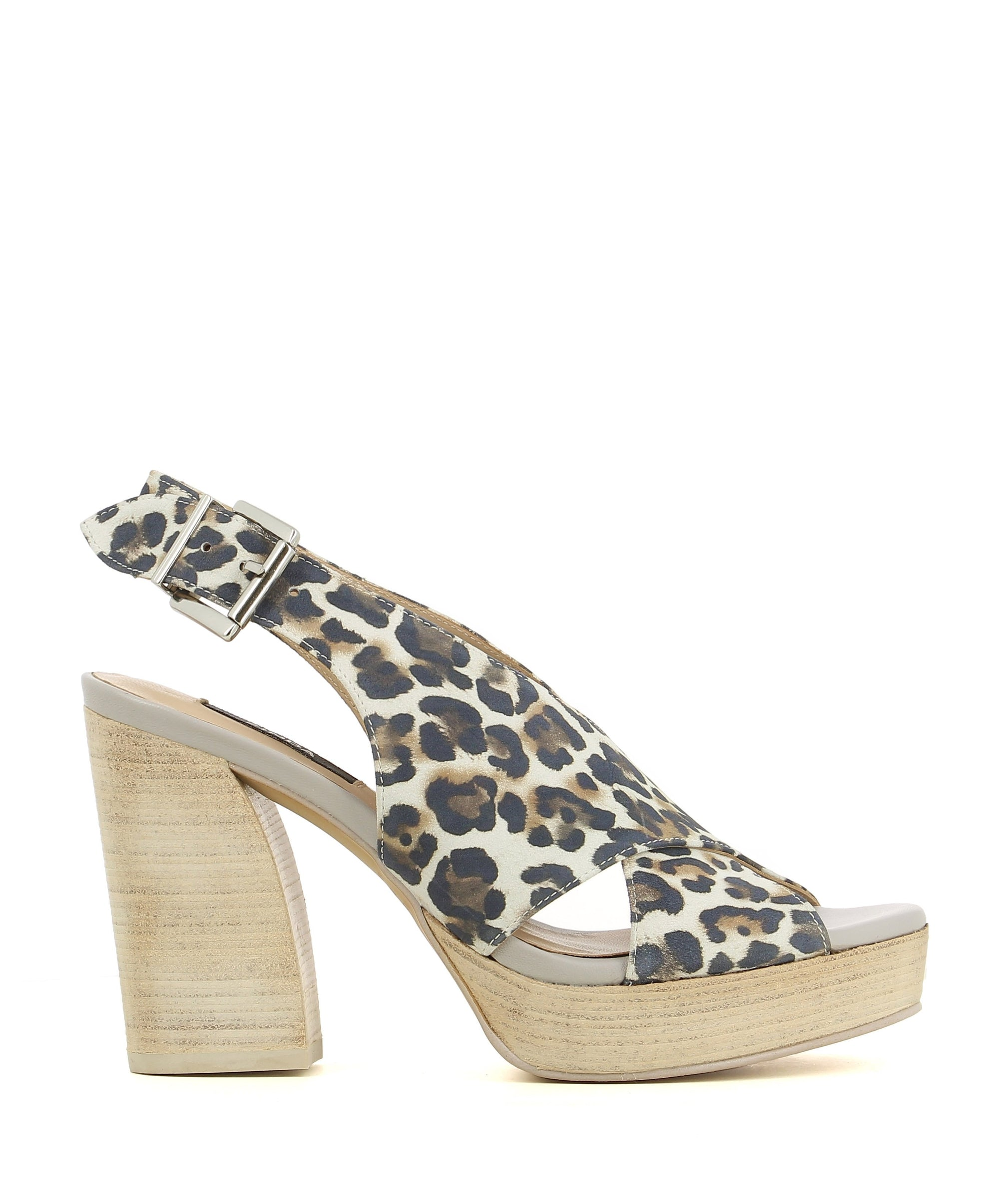 Statement leather platforms featuring a silver buckle fastening, a printed leopard print upper, a wooden platform heel and a soft almond toe by Zinda.