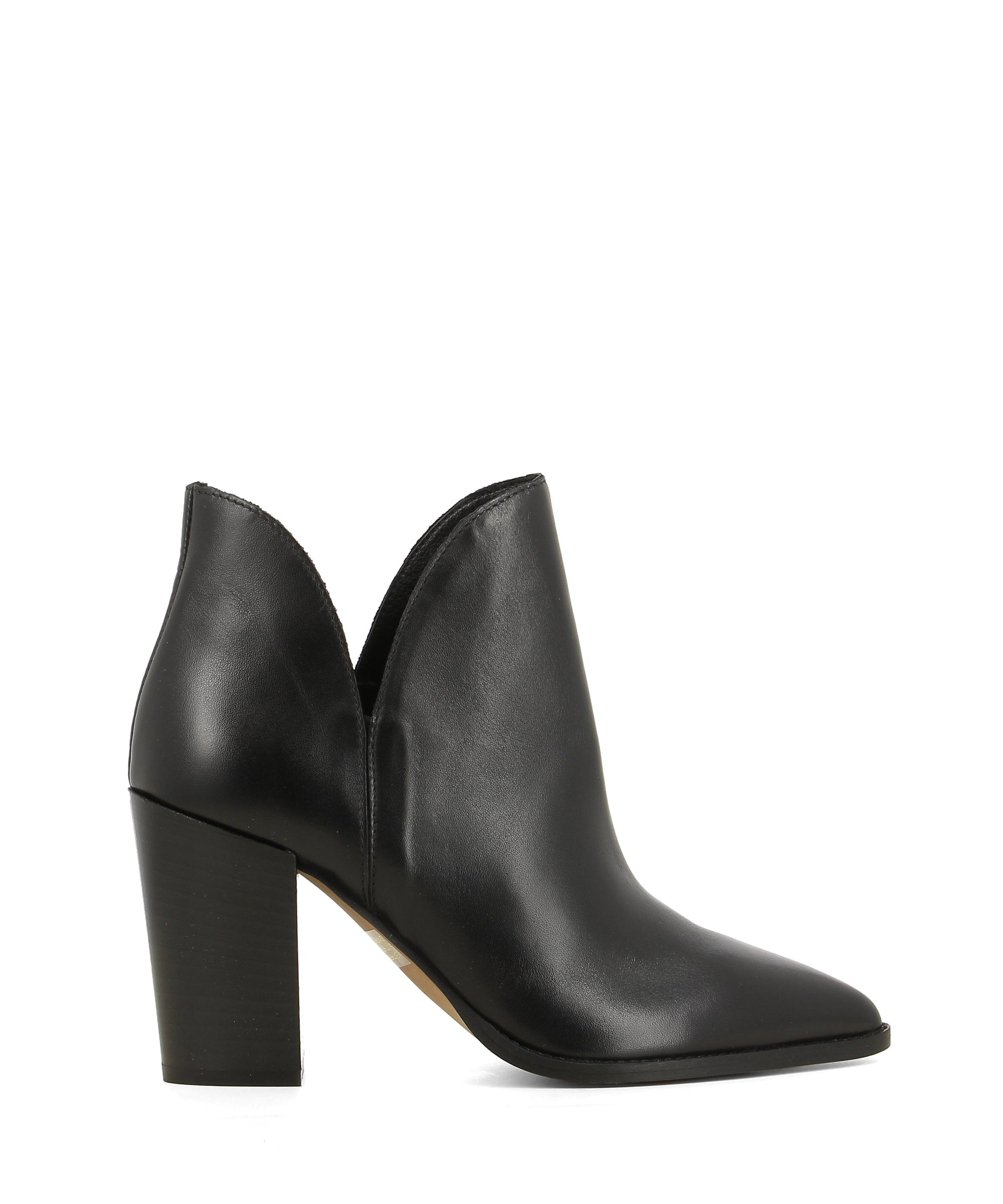 A black leather ankle boot featuring cut out sides, a tall block heel and a pointed toe by Christian Di Riccio. This style runs true to size.