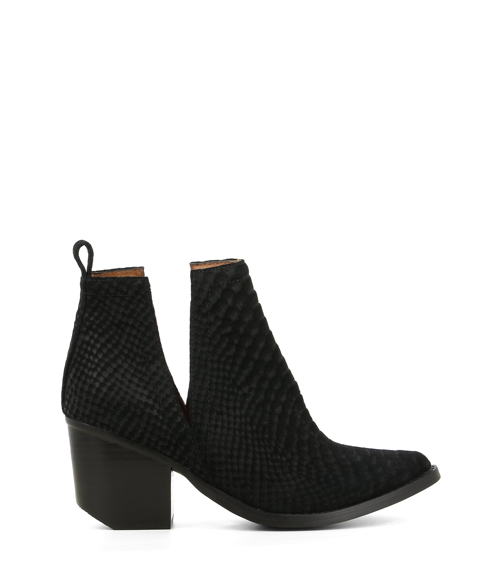 A slip on black suede, western style ankle boot with, a subtle snake print to the upper, a block heel and a pointed toe by Jeffrey Campbell.