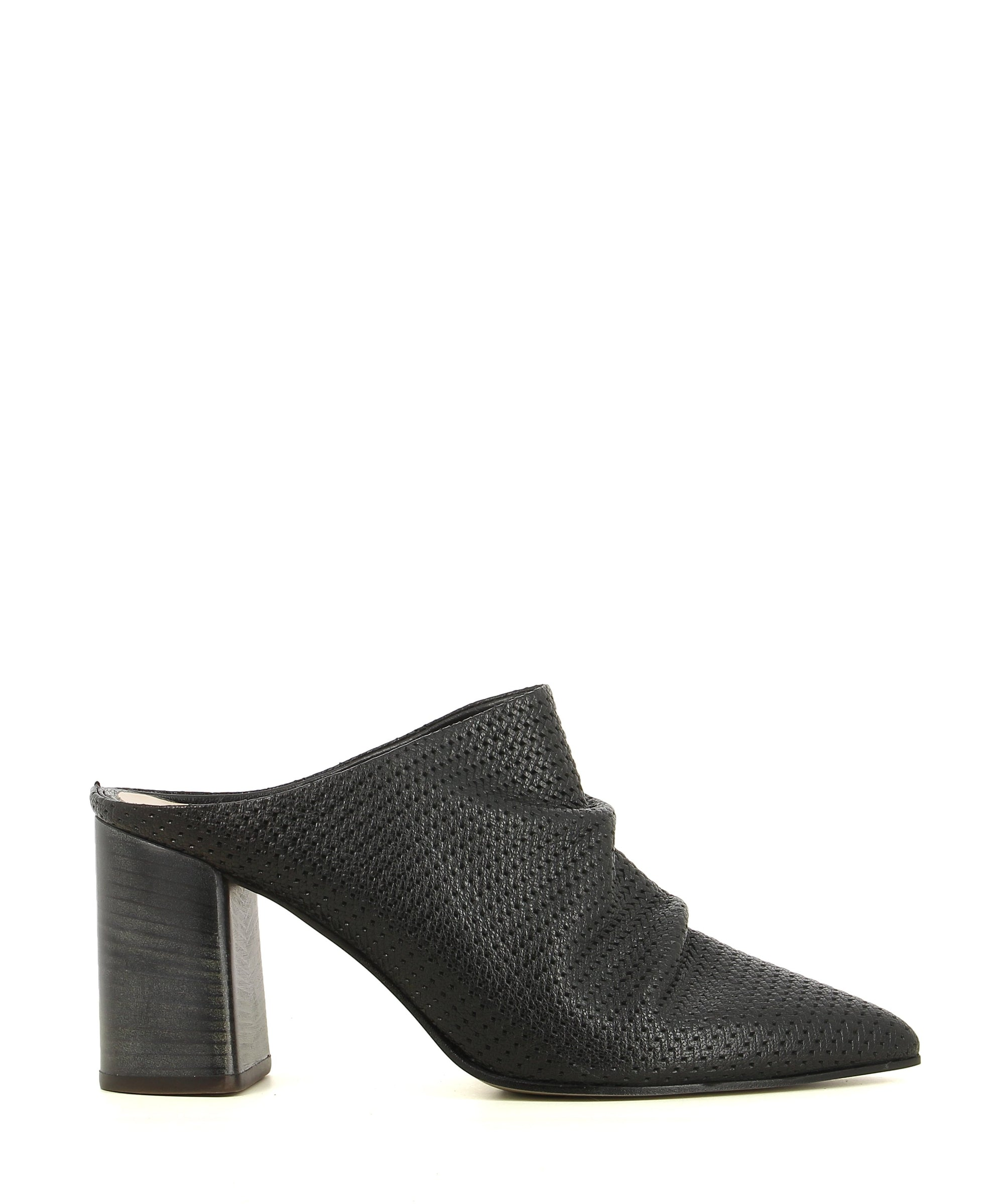 A black leather mule by Sempre Di. The '6574' features a slouched upper, a block heel, and a pointed toe.