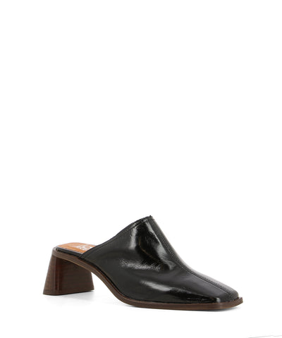 Black patent leather heeled mules that features a stacked wooden flared block heel and a square toe by Lokas.